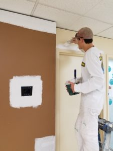 Painting the door trim in a office located in Seattle, Washington